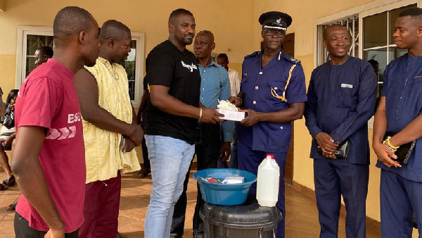 John Dumelo donates items to Ayawaso West police officers to fight coronavirus